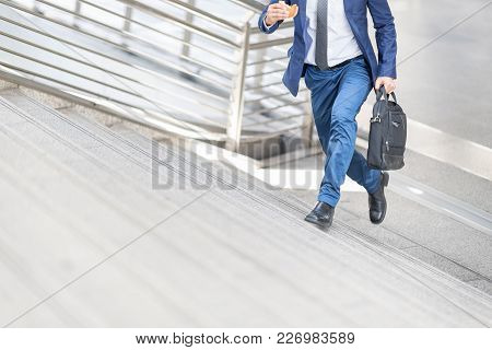 Businessman Is Running Up The Stair.confident And Active Businesspersons Creative Business  Work Out