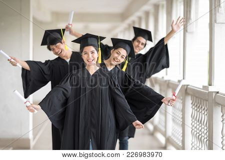 Graduation Day, Images Of Happily Graduates Are Celebrating Graduation, A Certificate In Hand, Happi
