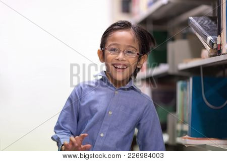 Happy Kids Lifestyle In The Library. Young People Explore Lifestlye In The Library. Cute Boy Is Exci