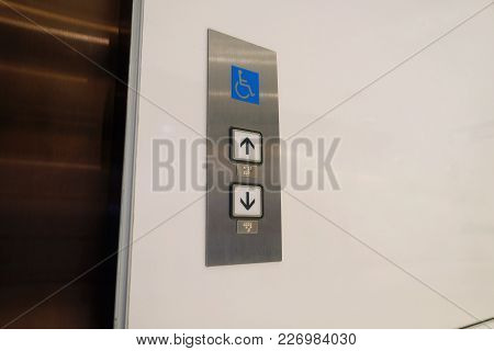Buttons Up And Down To Call Elevator With Braille Code For Blind Disabled People