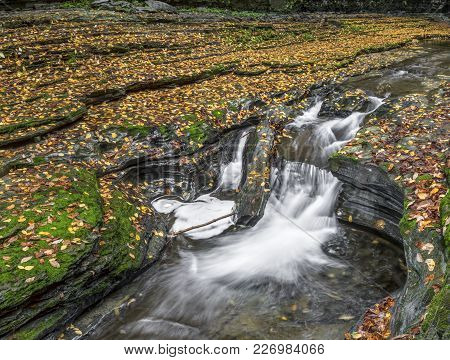 Water Splashes Through The Rocky And Colorful Autumn Landscape Of Watkins Glen State Park In The Fin