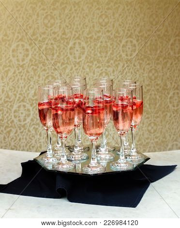 Closeup Of Glasses Of Champagne In A Row On A Table Champagne Waiter Serving Champagne On A Tray