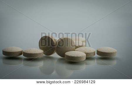 Macro Shot Detail Of Zinc Amino Acid Chelate Tablets Pills On White Background. Dietary Supplement P