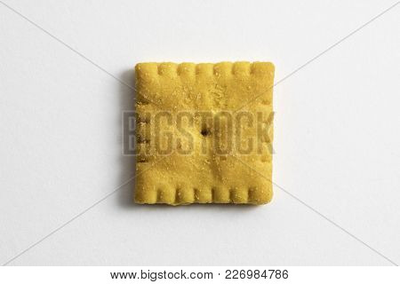 Cheese Flavored Small Square Cracker On A White Background