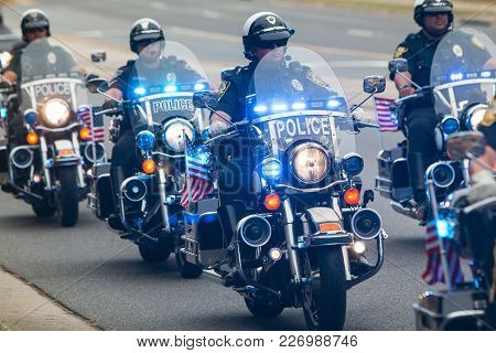 Buford, Ga - October 2017:  Several Motorcycle Cops Provide An Escort To A Group Of Motorcyclists Ab