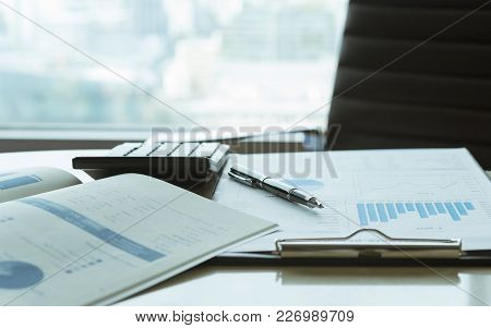 Financial Services. Pen With Business Report On Financial Advisor Desk. Concept Of Business Planning