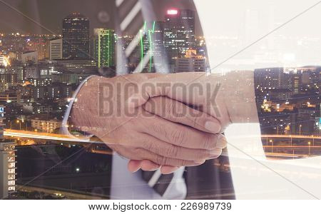 Business People Shaking Hand With City Background. Agreement, Partnership, Greeting, Dealing, Merger