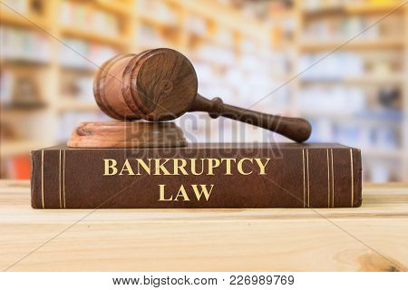 Bankruptcy Law Books With A Judges Gavel On Desk In The Library. Concept Of Bankruptcy Law,bankrupt,