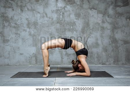 Young Attractive Woman Practicing Yoga, Stretching In Elbow Bridge Exercise, Urdhva Dhanurasana Pose