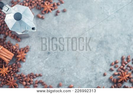 Geyser Coffee Maker Top View With Coffee Beans, Cinnamon, And Anise Stars On A Concrete Background.