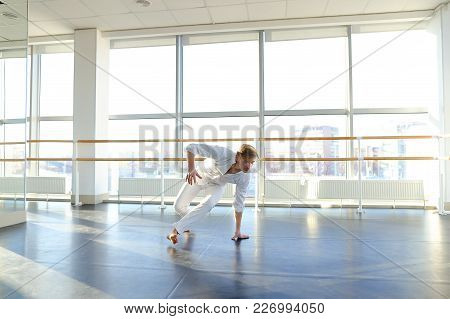 Graduate Of Dance School Moves In White Suit. Happy Guy Raving At Gym. Concept Of Promotion To Start