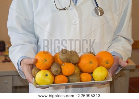 Slim Down Dieting Concept. Doctor In White Lab Coat Recommending Healthy Food. Doctor Specialist Die
