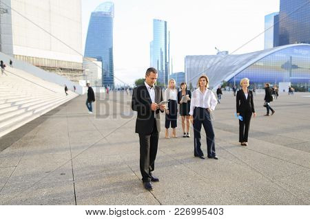 Business Person From Back Walking Outside With Blue Document Case In  . Concept Of Successful Female