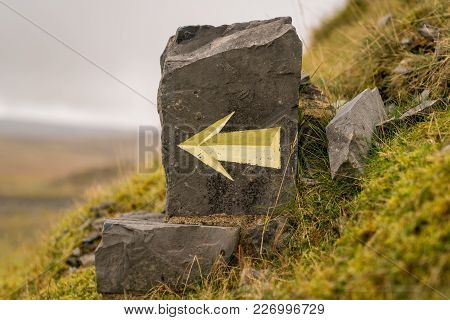 Directional Arrow Carved In A Stone, Seen At The Black Mountain Quarries In Carmarthenshire, Dyfed,