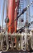A fragment of a rigging of a sailing ship. The mast of a sailing frigate with ropes poster