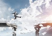 Businessman jumping over gap in bridge among flying paper planes as symbol of overcoming challenges. Skyscape with sunlight and nature view on background. 3D rendering. poster
