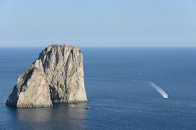 Faraglioni Rocks At Capri Island In Italy With Ships.