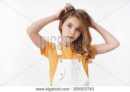Tender Lovely Young Blond Girl In Summer Dungarees Over Yellow T-shirt, Look Thoughtful And Cute Cam