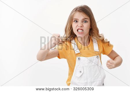 Angry Displeased And Distressed Hateful Blond Little Girl, Child Staring Furious And Upset, Complain