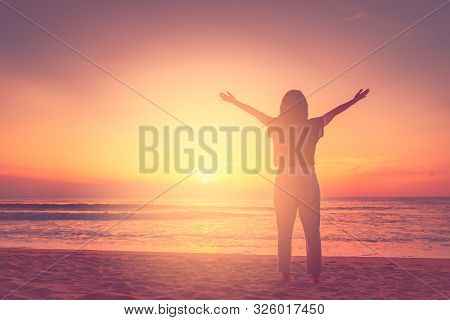 Copy Space Of Woman Rise Hand Up On Sunset Sky At Beach And Island Background. Freedom And Travel Ad