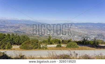 mountain view down to macedonian capitol skopje poster