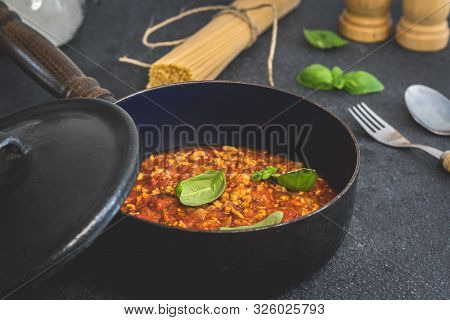 Traditional Italian Pasta Spaghetti Bolognese With Minced Meat, Tomato, Cheese Parmesan And Basil On