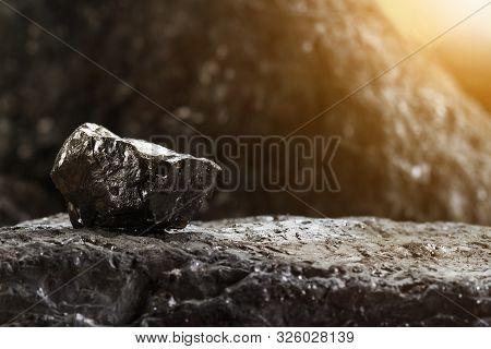 Black Coal Mine Close-up With Soft Focus. Anthracite Coal Bar On Dark Background. Natural Black Coal