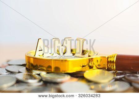 Wood Block Word Aml (anti Money Laundering) On Blurred Greenery Background. Money Laundering Concept