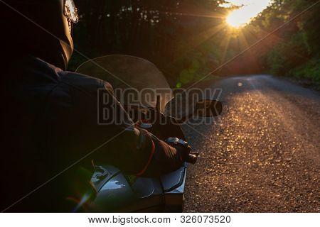 Biker With His Motorcycle On Street, Preparing For The Ride. Motorcycle Guy With Motorcycle On The R