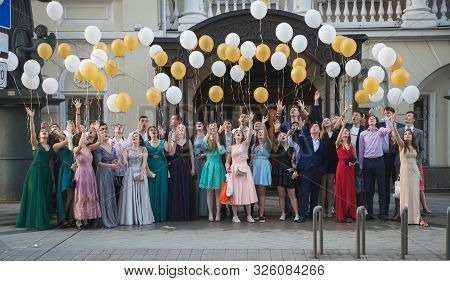 Moscow, Russia - June 24, 2016: Unidentified School Pupils In Formal Dress And Suit Greeting Their T