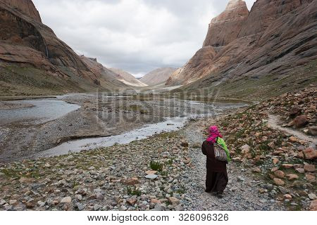 A Pilgrims Walks In The Barren Lha-chu Valley On The Path Around Mt. Kailash In Tibet, China - One O