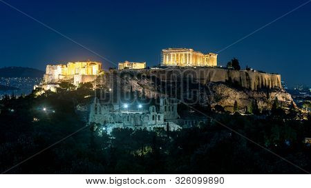 Acropolis Of Athens At Night, Greece. It Is A Top Landmark Of Athens. Scenic Panorama Of Illuminated