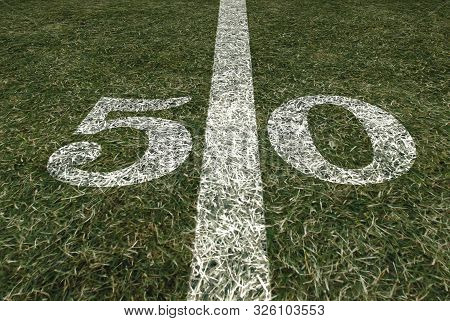 Friday Night Lights Football Game On Football Field Fifty Yard Line Background. An American Football
