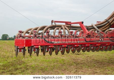 Closeup Of An Used Manure Injector (front)