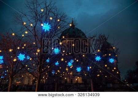 Christmas street light decoration in Berlin with Cathedral (Berliner Dom) in background. Mitte borough of Central Berlin, Germany poster