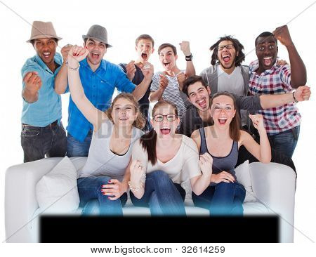 Young teenagers going crazy in front of TV. Isolated over white.