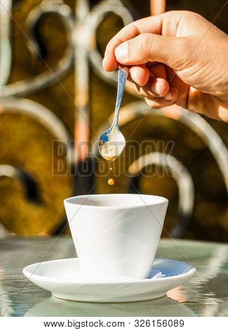 Close Up Of A Man Hands Holding A Hot Coffe Cups. Closeup. Coffe Time, Spoon. Black Coffee. Hand Of