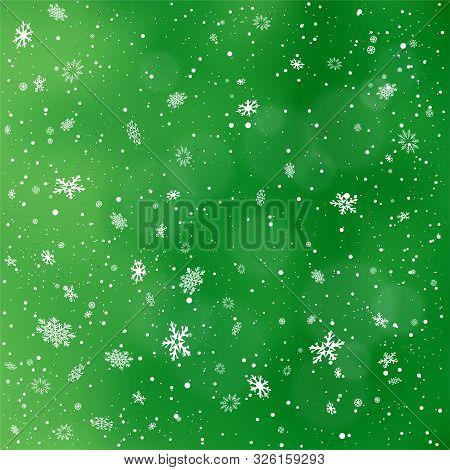 Closeup Snowfall On Green Backdrop. Winter Holiday Christmas Background. Big And Small Snowflakes Fa