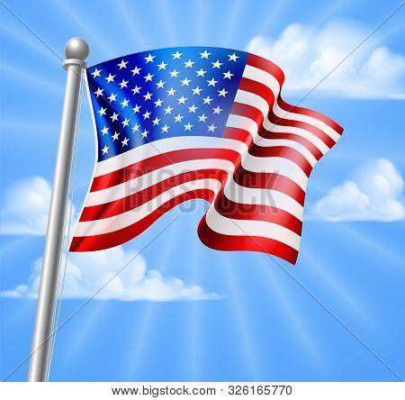 The American Flag On A Flag Pole Flying Against A Blue Sky