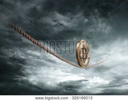 Bitcoin Coin Balancing On The Rope Over Dramatic Sky With Copy Space