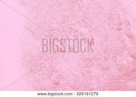 Pink Spangles Are Scattered On A Pink Background.