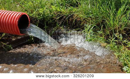 Pumping Water From The Flood Zone. Sewage System. Industrial Wastewater. Sewer Drains From A Plastic