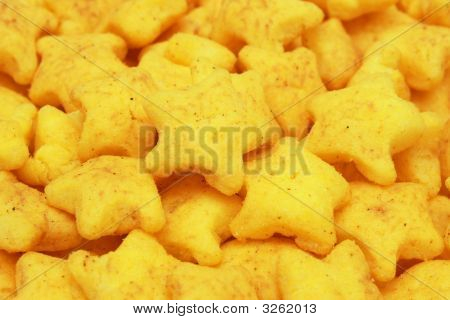 A pile of yellow snacks in star shape. poster