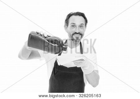 Cleanup concept. Get rid of stains. Smart cleaning solution. Cleaning service and household duty. Man in rubber gloves hold bottle liquid soap chemical cleaning agent. Bearded guy cleaning home. poster