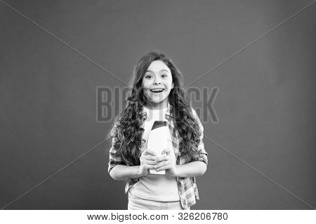 poster of Strong and healthy hair concept. Long lasting freshness. Fresh it up. Small child long hair. Shampoo bottle. Girl active kid with long hair. Dry shampoo. Easy tips making hairstyle for kids.