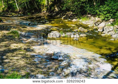 Finland, Kotka: Langinkoski Rapid On The Kumi River, Fast Forest Creek With Granite Rocks.