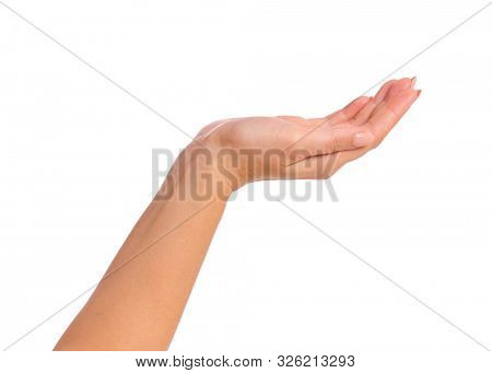 Female empty hand holding something - palm up, isolated on white background. Beautiful hand of woman with copy space.