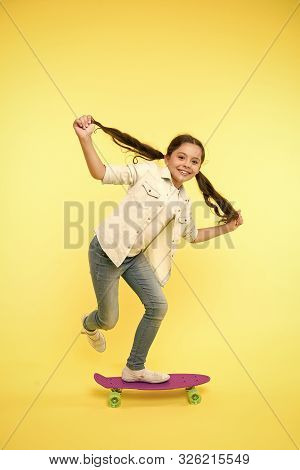 Hobby Favorite Activity. Child Smiling Face Stand On Skateboard. Penny Board Cute Colorful Skateboar