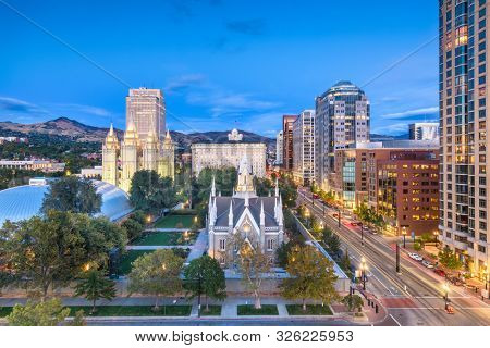 Salt Lake City, Utah, USA downtown cityscape over Temple Square at dusk.