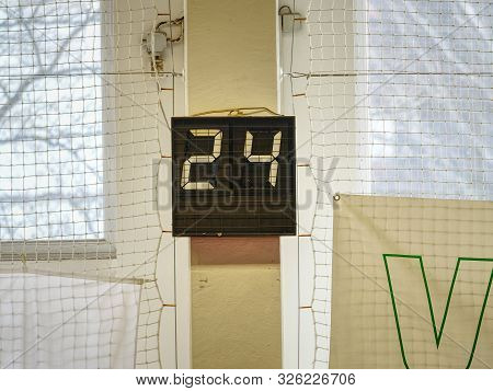 Glowing Sport Football Mechanical Or Digital  Scoreboard And Result Display On Gymnasium Wall